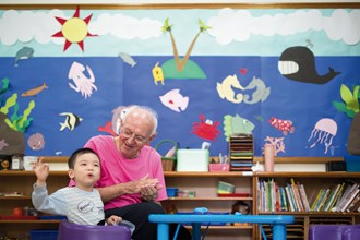At the Guangming Early Intervention and Education Center, Fr. Peter employs love and patience to help the children grow. (photo by Lin Min-hsuan)