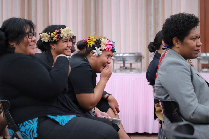 Participants in the 2018 Pacific Islands Leadership Program with Taiwan wear traditional Pacific Island flower headdresses at the program's closing ceremony.