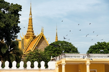 Phnom Penh's Royal Palace, a cultural icon, sparkles in the sunlight.