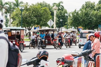 Business is booming in downtown Phnom Penh, and so is traffic.