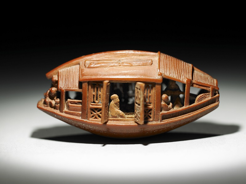"NPM's iconic sculpture ""Ganlan olive stone miniature boat with the Ode to the Red Cliff carved on the bottom,"" is approximately 3.4 centimeters long and 1.4 cm wide. (Courtesy of NPM)"
