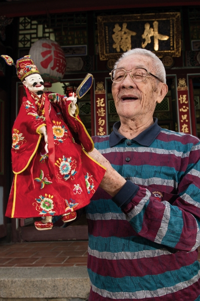 With a puppet on his hand, Chen's face comes alive. He and the puppet mirror one another, like old friends.