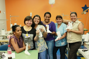 """The Sunshine Social Welfare Foundation unselfishly shared its techniques for fabricating """"pressure garments,"""" putting smiles of confidence on the faces of the seamstresses who acquired the skills to make the garments."""