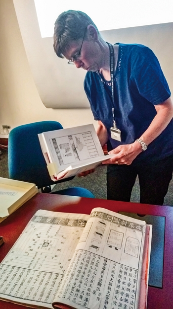 In May 2018, the NCL established a Taiwan Resource Center for Chinese Studies in Denmark, marking the centers' first outpost in Scandinavia. Here, Eva-Maria Jansson, director of the Oriental Collection Department at the Royal Danish Library, shows a selection of the department's ancient Chinese tomes. (courtesy of NCL)