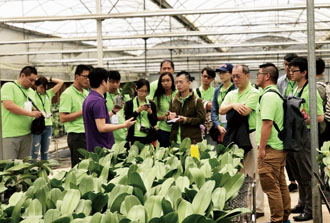 Young Agricultural Ambassadors Program participants visit an orchid greenhouse in Vietnam last year. (Photo courtesy of Ministry of Foreign Affairs)