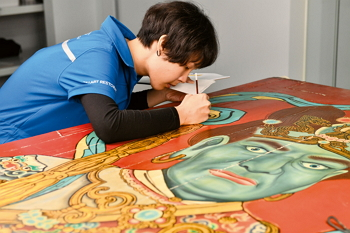 Working with great concentration, art conservators mitigate the ravages of time.