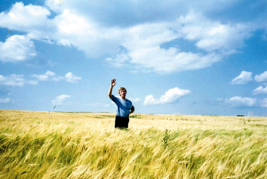 A photo of the young Ivan Yehorov taken by his wife, Marie Lin. The golden yellow of the wheat fields and the blue of the sky are the colors of the Ukrainian flag. (courtesy of Art of Ivan Yehorov)