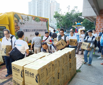 Volunteers with Taiwan People's Food Bank Association pack and ship rice and collect donations at an elementary school in Taichung. (Photo courtesy of Taiwan People's Food Bank Association)