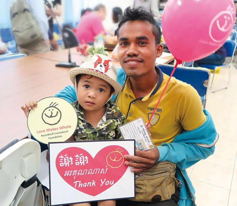 A Cambodian father and son express gratitude to Taipei City-based Noordhoff Craniofacial Foundation after the boy received treatment from NCF personnel at the National Pediatric Hospital in Phnom Penh in December 2017. (Photo courtesy of Noordhoff Craniofacial Foundation)