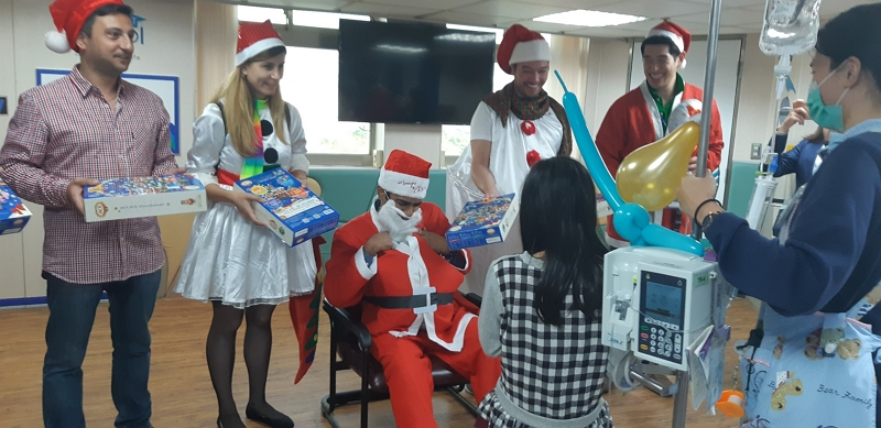 Giving out Christmas presents at the Children's Hospital, from left: Dr. Harutyunyan and Ani Latoyan from Armenia, Dr. Patel from India, Dr. Velazquez Mujica from Mexico, and Dr. Hamon Ng from Australia