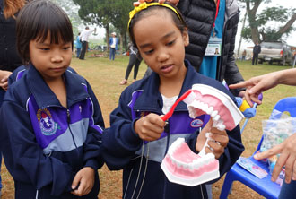 Young Thai nationals brush up on CCH-instructed oral hygiene techniques. (Photo courtesy of CCH)