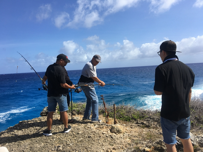 Nelson, center, enjoys fishing with his friends in Guam.
